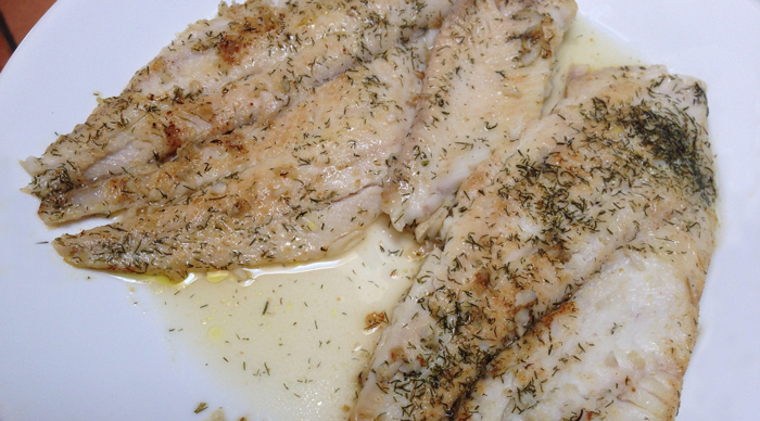 two-seared-sole-fish-fillets-with-herb-butter-sauce-on-dinner-plate-cooking-class