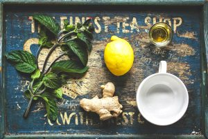 tea-ginger-honey-lemon-mint-ingredients-on-old-worn-wood-tray-with-white-tea-cup