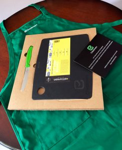 swag-for-online-cooking-class-cutting-board-knife-apron-with-checkmarx-logo