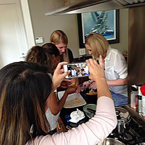 kitchen-scene-with-women-actively-cooking-team-building-cooking-class-party-Mystery-Basket-Challenge-competition