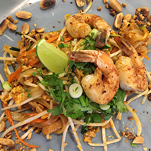 dinner-plate-with-cilantro-lime-peanuts-on-top-of-shrimp-pad-thai-cooking-class-couples-groups