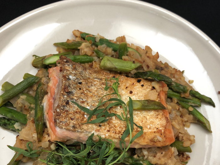 dinner-plate-with-crispy-skin-pan-seared-Salmon-sauteed-Riced-Cauliflower-caramelized-shallots-fresh-tarragon-sprig-leaves