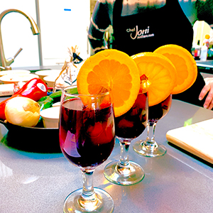 learn-how-to-make-Sangria-with-orange-wheels-paella-cooking-class