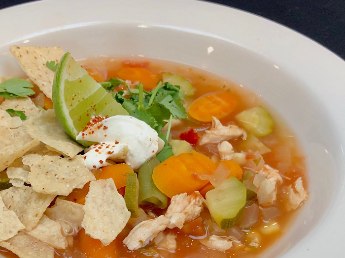 Mexican-cubed-Chicken-Vegetable-Tortilla-soup-garnish-sour-cream-lime-paprika-tortilla-chip-cropped-bowl-online-cooking-class