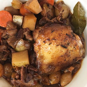 enticing-photo-of-perfectly-cooked-coq-au-vin-with-cubed-vegetables-pearl-onions-bacon-bay-leaf-herbs-french-cooking-class-couples-groups