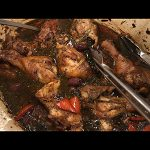 seven-braised-chicken-legs-skin-on-with-herbs-in-dutch-oven-tongs-with-kalamata-olives-red-bell-peppers-onion-garlic-wine