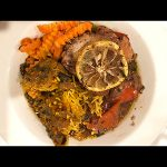 braised-chicken-thigh-skin-on-bone-in-dinner-plate-crinkle-carrots-bell-pepper-rice-lemon-wheel-mediterranean-cooking-class