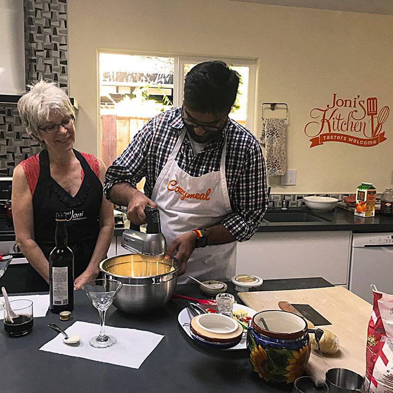 chef-joni-sare-with-student-using-electric-mixer-making-tiramisu-italian-cooking-class