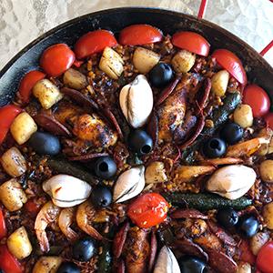 top-view-full-paella-shrimp-scallops-clams-black-olives-chicken-chorizo-paella-cooking-class