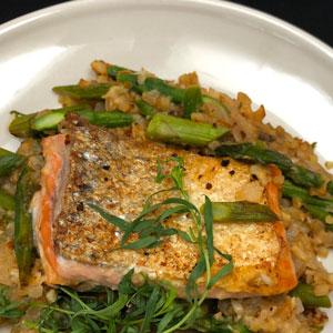 dinner-plate-with-crispy-skin-pan-seared-Salmon-sauteed-Riced-Cauliflower-caramelized-shallots-fresh-tarragon-sprig-leaves