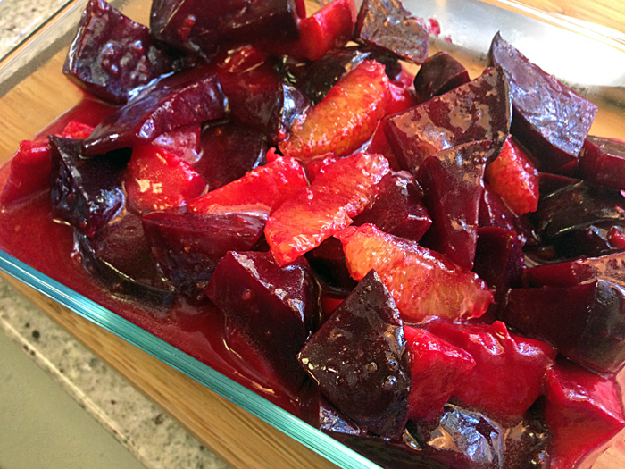 deep-red-colored-roasted-red-beets-accented-with-fresh-orange-segments-tossed-with-ginger-orange-glaze-catering