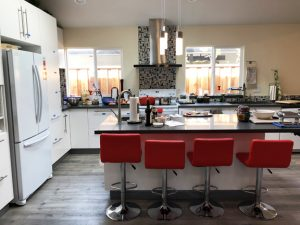 modern-contempary-kitchen-island-bar-stools-cabinets-stove-