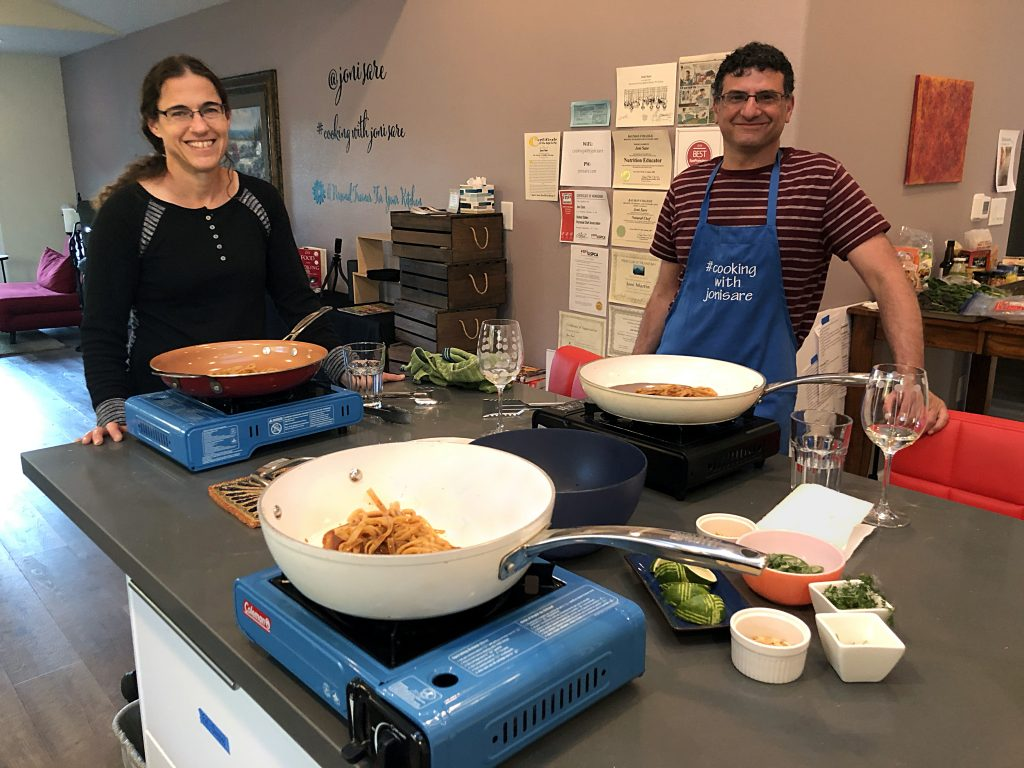 private-at-home-in-person-cooking-class-man-and-woman-cooking